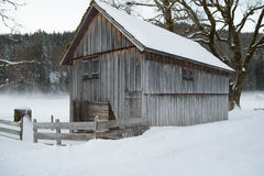 Wooden cottage in snow covered country. Small wooden cottage in snow covered country Royalty Free Stock Photos