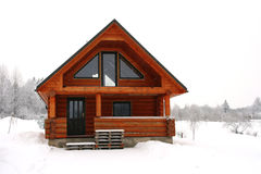 Wooden cottage in a snowy place Royalty Free Stock Photo