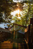 Wooden cottage steps leading down to the lake Stock Photos