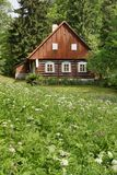 Wooden cottage in summer Stock Photo