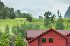 Wooden cottage in the valley. Stock Photos