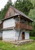 Wooden cottage in village Stock Photo