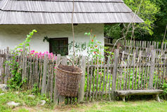 Wooden cottage in village Royalty Free Stock Photos