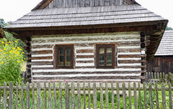 Wooden cottage in village Royalty Free Stock Images