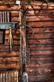 Wooden cottage wall with tools. Tools hanging on a wall made of wood Stock Photography
