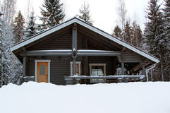 Wooden cottage in winter forest Stock Photo