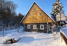 Wooden cottage in winter Stock Photo