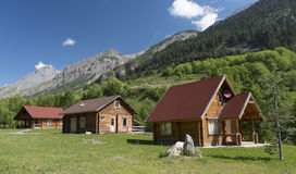 Wooden cottages in the Alps Royalty Free Stock Photos