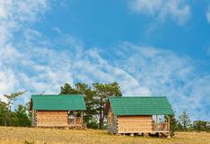Wooden cottages. On blue sky Royalty Free Stock Image
