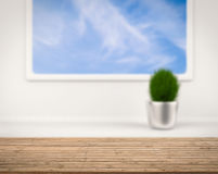 Wooden counter with blue sky view from window Stock Photography