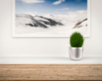 Wooden counter with snow mountain view from window Royalty Free Stock Photography