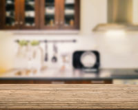 Wooden counter top with kitchen background. Wooden counter top with kitchen blurred background Royalty Free Stock Photos