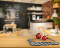 Wooden counter top with tomato and chopping board Stock Photos
