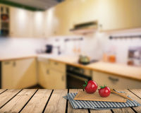 Wooden counter top with tomato and chopping board Stock Photo