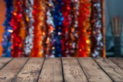 Wooden countertops on the background of Christmas tinsel blur with bokeh Stock Photography
