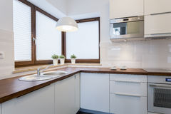 Wooden countertops in traditional kitchen. Wooden countertops and white cupboards in traditional kitchen Stock Photos