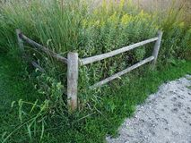 Wooden farm fence. Wooden country farm corner fence Royalty Free Stock Photography