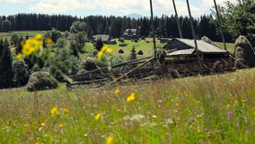 Wooden country house, green lawn and blue sky stock footage
