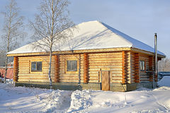Wooden Country small house of timber stained yellow, snowy winte Royalty Free Stock Photography