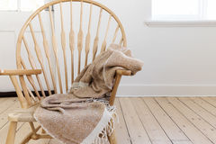 Wooden country style chair with textured throw blanket and space Stock Photos