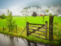 Wooden countryside gate at farm, Norway. Stock Photo