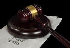 Wooden court gavel on newspaper Stock Image