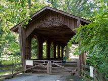 Wooden covered bridge Stock Image
