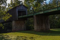A wooden covered bridge across the Euharlee Creek in Georgia. royalty free stock images