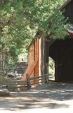 Wooden covered bridge over a river in the Sierras Stock Photo