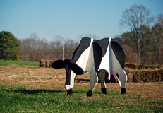 Wooden Cow. Decorative cow in a field Stock Images