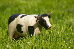Wooden cow. Wodden cow in the meadow Stock Image