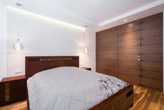 Wooden cozy bedroom Stock Image