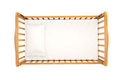 Wooden cradle for baby with pillow isolated on white background,. Top view Royalty Free Stock Photos