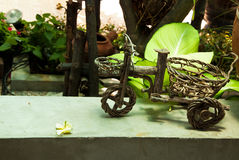 Wooden craft cart in garden Royalty Free Stock Photos