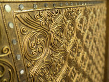 Wooden craft gold-painted. Stock Image