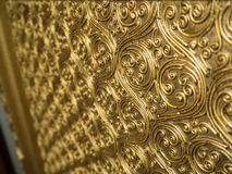 Wooden craft gold-painted. Stock Photography