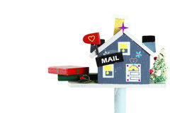 Wooden craft house mailbox with gift box of holiday Stock Photography