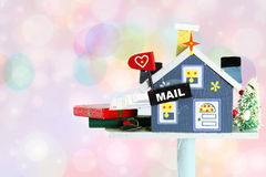 Wooden craft house mailbox with letter and gift box of holiday Royalty Free Stock Photos