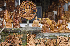 Wooden crafted figurines in a souvenir shop Stock Photography