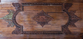 Wooden crafted roof wall. Ancient hand art work of roof wall in Myanmar with beatiful crafted Stock Photo