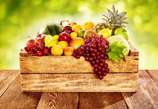 Wooden crate filled with fresh healthy fruit Stock Image