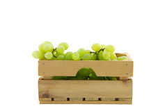 Wooden crate filled with white grapes isolated on white Stock Images