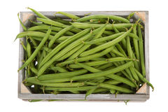 Wooden crate with Fresh green beans viewed from above Royalty Free Stock Images