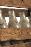Wooden crate. Full of old milk bottles Royalty Free Stock Photography