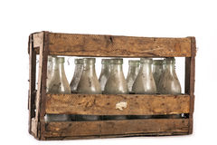 Wooden crate. Full of old milk bottles Stock Photo