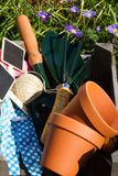 Wooden crate with garden utensils in garden Royalty Free Stock Photos