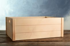 Wooden crate on table stock images
