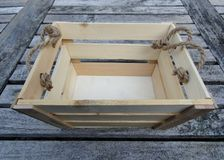 Wooden crate on a table Royalty Free Stock Image