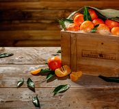 Wooden crate with tasty tangerines Royalty Free Stock Images