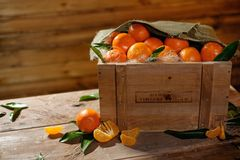 Wooden crate with tasty tangerines Royalty Free Stock Photography